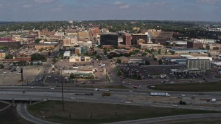 DX0002_174_017 - 5.7K stock footage aerial video ascend over I-29 with a view of Downtown Sioux City, Iowa