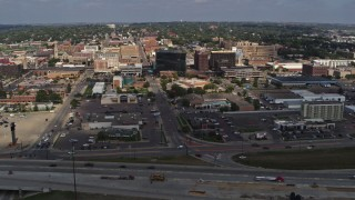 DX0002_174_018 - 5.7K stock footage aerial video a view of office buildings while passing by I-29, Downtown Sioux City, Iowa