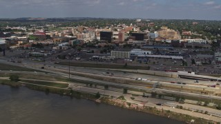 DX0002_174_019 - 5.7K stock footage aerial video flyby and away from I-29 highway with a view of Downtown Sioux City, Iowa