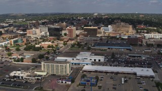 DX0002_174_023 - 5.7K stock footage aerial video reverse view of office buildings in Downtown Sioux City, Iowa