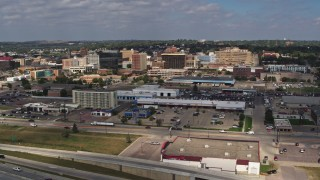 DX0002_174_024 - 5.7K stock footage aerial video of office buildings in Downtown Sioux City, Iowa, seen during descent
