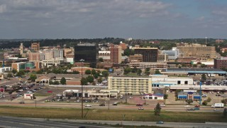 DX0002_174_025 - 5.7K stock footage aerial video fly away from and by office buildings in Downtown Sioux City, Iowa