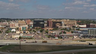 DX0002_174_026 - 5.7K stock footage aerial video of office buildings and fast food restaurants by highway in Downtown Sioux City, Iowa