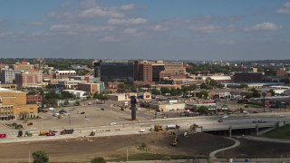 DX0002_174_027 - 5.7K stock footage aerial video stationary view of office buildings and fast food restaurants by highway in Downtown Sioux City, Iowa