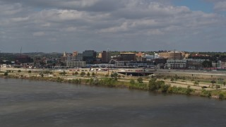 DX0002_174_031 - 5.7K stock footage aerial video of office buildings in Downtown Sioux City, Iowa, descend by Missouri River