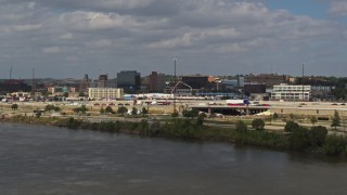 DX0002_174_032 - 5.7K stock footage aerial video fly over Missouri River and ascend for view of office buildings in Downtown Sioux City, Iowa