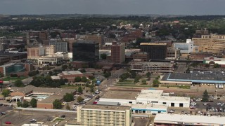DX0002_174_034 - 5.7K stock footage aerial video slowly passing office buildings in Downtown Sioux City, Iowa