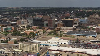DX0002_174_035 - 5.7K stock footage aerial video slowly flying by office buildings in Downtown Sioux City, Iowa