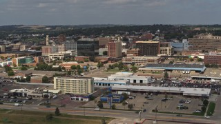 DX0002_174_036 - 5.7K stock footage aerial video of office buildings in Downtown Sioux City, Iowa, descend near highway