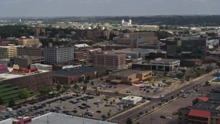 DX0002_175_002 - 5.7K stock footage aerial video passing office buildings, Downtown Sioux City, Iowa