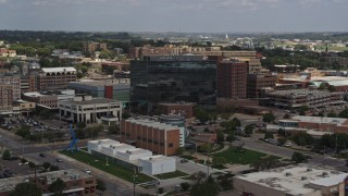 DX0002_175_004 - 5.7K stock footage aerial video of Ho-Chunk Centre and nearby office buildings, Downtown Sioux City, Iowa