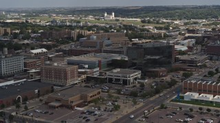 DX0002_175_005 - 5.7K stock footage aerial video flying by Ho-Chunk Centre and nearby office buildings, Downtown Sioux City, Iowa
