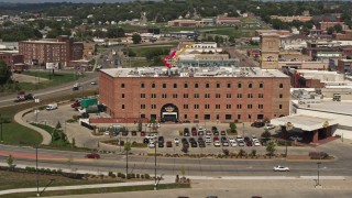 DX0002_175_011 - 5.7K stock footage aerial video orbit and fly away from the Hard Rock Hotel and Casino, Downtown Sioux City, Iowa