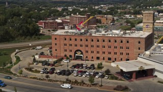 DX0002_175_013 - 5.7K stock footage aerial video flying toward the Hard Rock Hotel and Casino, Downtown Sioux City, Iowa