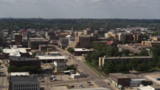 DX0002_175_015 - 5.7K stock footage aerial video of a hospital and city buildings, Downtown Sioux City, Iowa