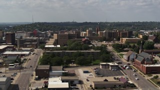 DX0002_175_017 - 5.7K stock footage aerial video descend while focused on hospital, Downtown Sioux City, Iowa