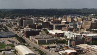DX0002_175_021 - 5.7K stock footage aerial video flying by office buildings and the convention center, Downtown Sioux City, Iowa