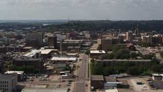 DX0002_175_022 - 5.7K stock footage aerial video flying by office buildings, 5th Street, and hospital, Downtown Sioux City, Iowa