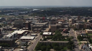 DX0002_175_023 - 5.7K stock footage aerial video a stationary view of office buildings and hospital, Downtown Sioux City, Iowa