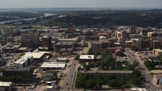 DX0002_175_024 - 5.7K stock footage aerial video flying by 5th Street between office buildings and hospital, Downtown Sioux City, Iowa