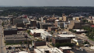 DX0002_175_025 - 5.7K stock footage aerial video flying by the convention center and office buildings, Downtown Sioux City, Iowa
