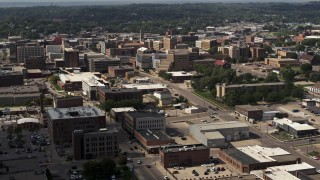 DX0002_175_030 - 5.7K stock footage aerial video passing the downtown area of the city, approach hospital, Downtown Sioux City, Iowa