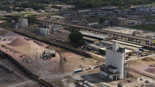 DX0002_175_031 - 5.7K stock footage aerial video of a train passing warehouse and industrial buildings in Sioux City, Iowa