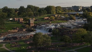 DX0002_176_001 - 5.7K stock footage aerial video of the falls at Falls Park at sunset in Sioux Falls, South Dakota