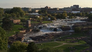 DX0002_176_002 - 5.7K stock footage aerial video of an orbit of the falls at Falls Park at sunset in Sioux Falls, South Dakota
