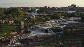 DX0002_176_004 - 5.7K stock footage aerial video of the waterfalls at Falls Park at sunset in Sioux Falls, South Dakota