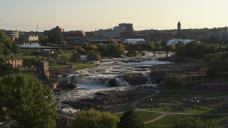 DX0002_176_005 - 5.7K stock footage aerial video of orbiting the waterfalls at Falls Park at sunset in Sioux Falls, South Dakota