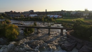 DX0002_176_014 - 5.7K stock footage aerial video bridge spanning the river at sunset in Sioux Falls, South Dakota