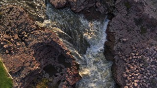DX0002_176_017 - 5.7K stock footage aerial video a bird's eye view of rapids on the river at sunset in Sioux Falls, South Dakota