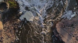 DX0002_176_018 - 5.7K stock footage aerial video a bird's eye view of rapids at sunset in Sioux Falls, South Dakota
