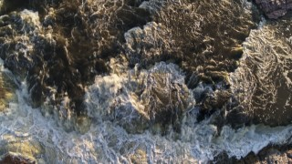 DX0002_176_019 - 5.7K stock footage aerial video a bird's eye view of waterfalls at sunset in Sioux Falls, South Dakota
