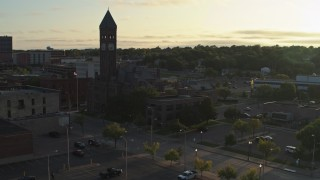 DX0002_176_022 - 5.7K stock footage aerial video approach the Old Courthouse Museum at sunset in Downtown Sioux Falls, South Dakota
