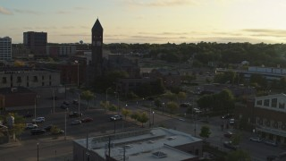 DX0002_176_023 - 5.7K stock footage aerial video reverse view of the Old Courthouse Museum at sunset in Downtown Sioux Falls, South Dakota