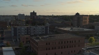 DX0002_176_024 - 5.7K stock footage aerial video stationary view of apartment buildings, approach the Old Courthouse Museum at sunset in Downtown Sioux Falls, South Dakota