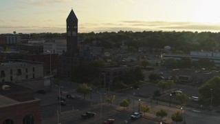 DX0002_176_025 - 5.7K stock footage aerial video of flying toward the Old Courthouse Museum at sunset in Downtown Sioux Falls, South Dakota