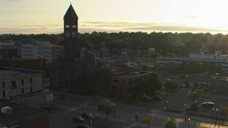 DX0002_176_026 - 5.7K stock footage aerial video stationary view of Old Courthouse Museum at sunset in Downtown Sioux Falls, South Dakota