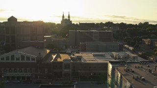 DX0002_176_027 - 5.7K stock footage aerial video orbit county buildings, cathedral in background at sunset in Downtown Sioux Falls, South Dakota