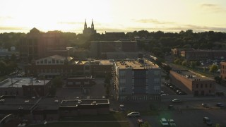 DX0002_176_030 - 5.7K stock footage aerial video pass by apartment, county office buildings, cathedral at sunset in Downtown Sioux Falls, South Dakota