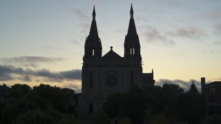 DX0002_176_031 - 5.7K stock footage aerial video of the Cathedral of Saint Joseph at twilight in Sioux Falls, South Dakota