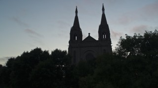 DX0002_176_032 - 5.7K stock footage aerial video ascend and reveal the Cathedral of Saint Joseph at twilight in Sioux Falls, South Dakota