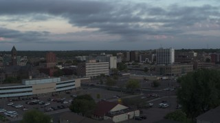 DX0002_176_034 - 5.7K stock footage aerial video flyby and away from the city's downtown area at twilight, Downtown Sioux Falls, South Dakota