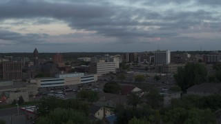 DX0002_176_035 - 5.7K stock footage aerial video ofpassing by the city's downtown area at twilight, Downtown Sioux Falls, South Dakota