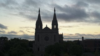 DX0002_176_036 - 5.7K stock footage aerial video orbiting the Cathedral of Saint Joseph at twilight in Sioux Falls, South Dakota