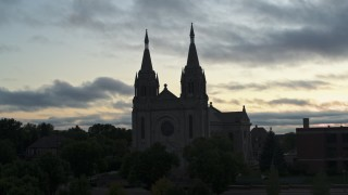 DX0002_176_037 - 5.7K stock footage aerial video circling the Cathedral of Saint Joseph at twilight in Sioux Falls, South Dakota