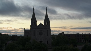 DX0002_176_038 - 5.7K stock footage aerial video close orbit of the Cathedral of Saint Joseph at twilight in Sioux Falls, South Dakota