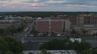 DX0002_176_039 - 5.7K stock footage aerial video of circling a county government building at twilight, Downtown Sioux Falls, South Dakota